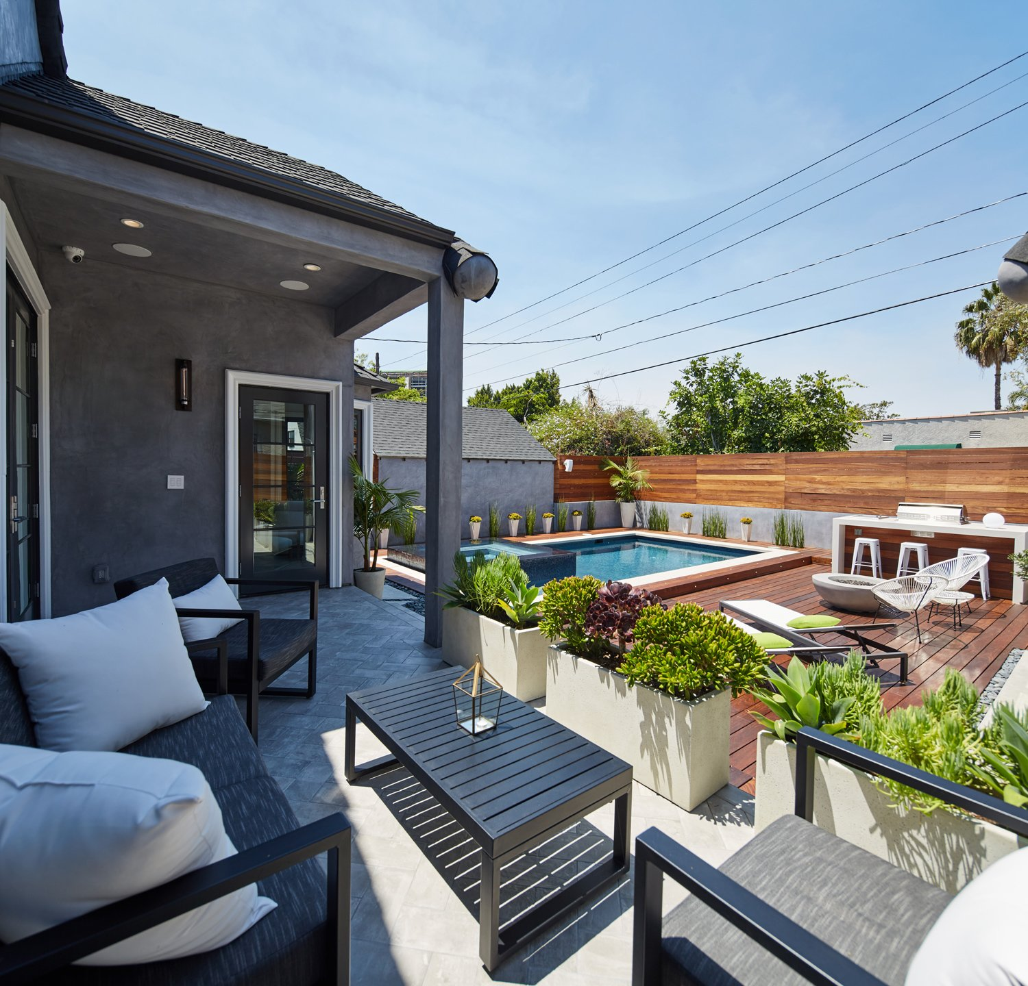 Back yard Tagged: Outdoor, Walkways, Raised Planters, Salt Water, Hardscapes, Swimming, Small, Wood, Large, Wood, Horizontal, Decking, and Landscape.  Best Outdoor Decking Landscape Photos from West Hollywood Tudor
