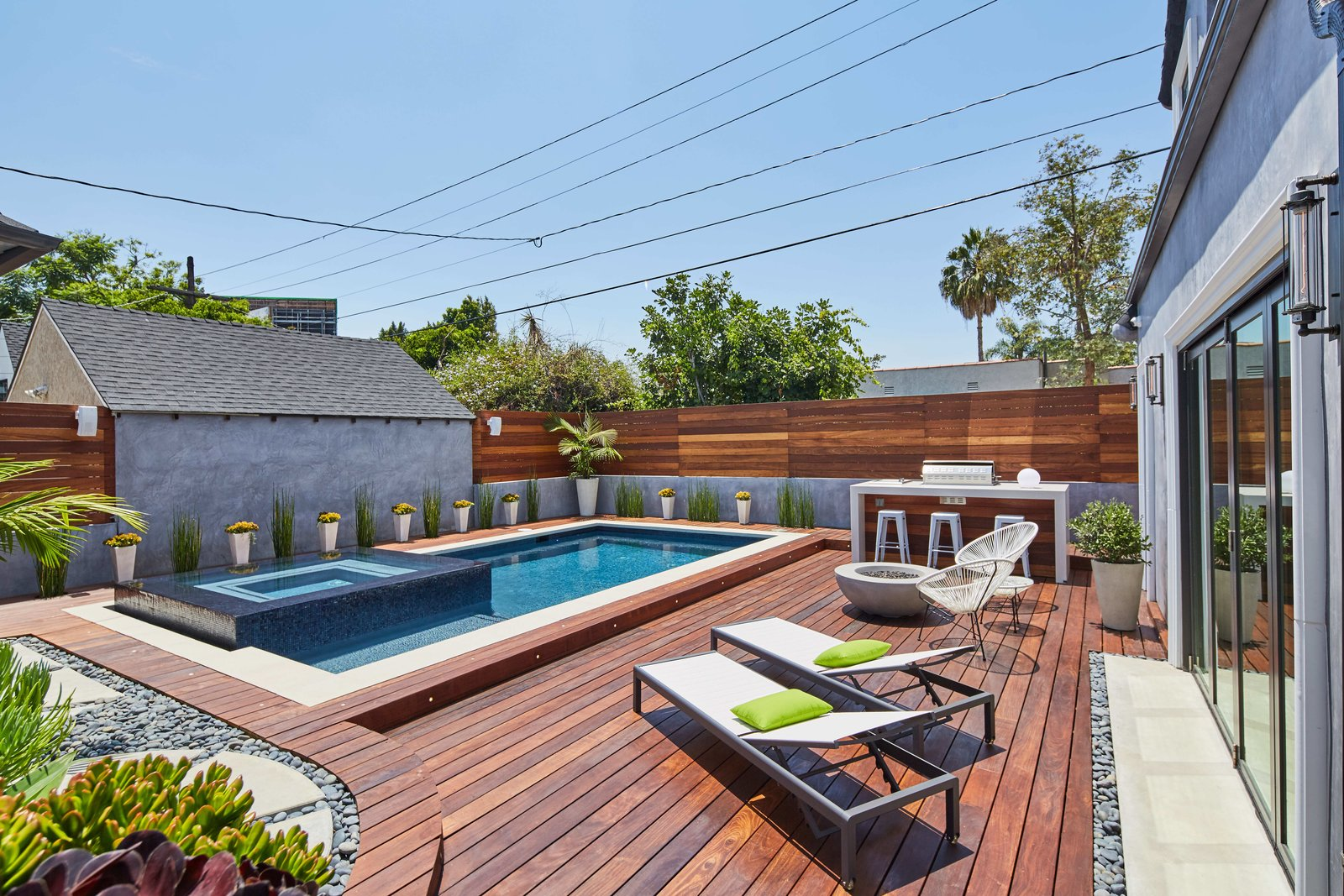 Back yard, Pool deck Tagged: Outdoor, Swimming, Raised Planters, Back Yard, Small, Large, Salt Water, Decking, Wood, Wood, Landscape, and Horizontal.  Best Outdoor Decking Landscape Photos from West Hollywood Tudor