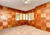 Modern home with Office, Medium Hardwood Floor, and Study. Checkerboard room of custom Mahogany paneling and Soji screens. This is being turned into an eclectic man cave. Photo 4 of Weaver Drive