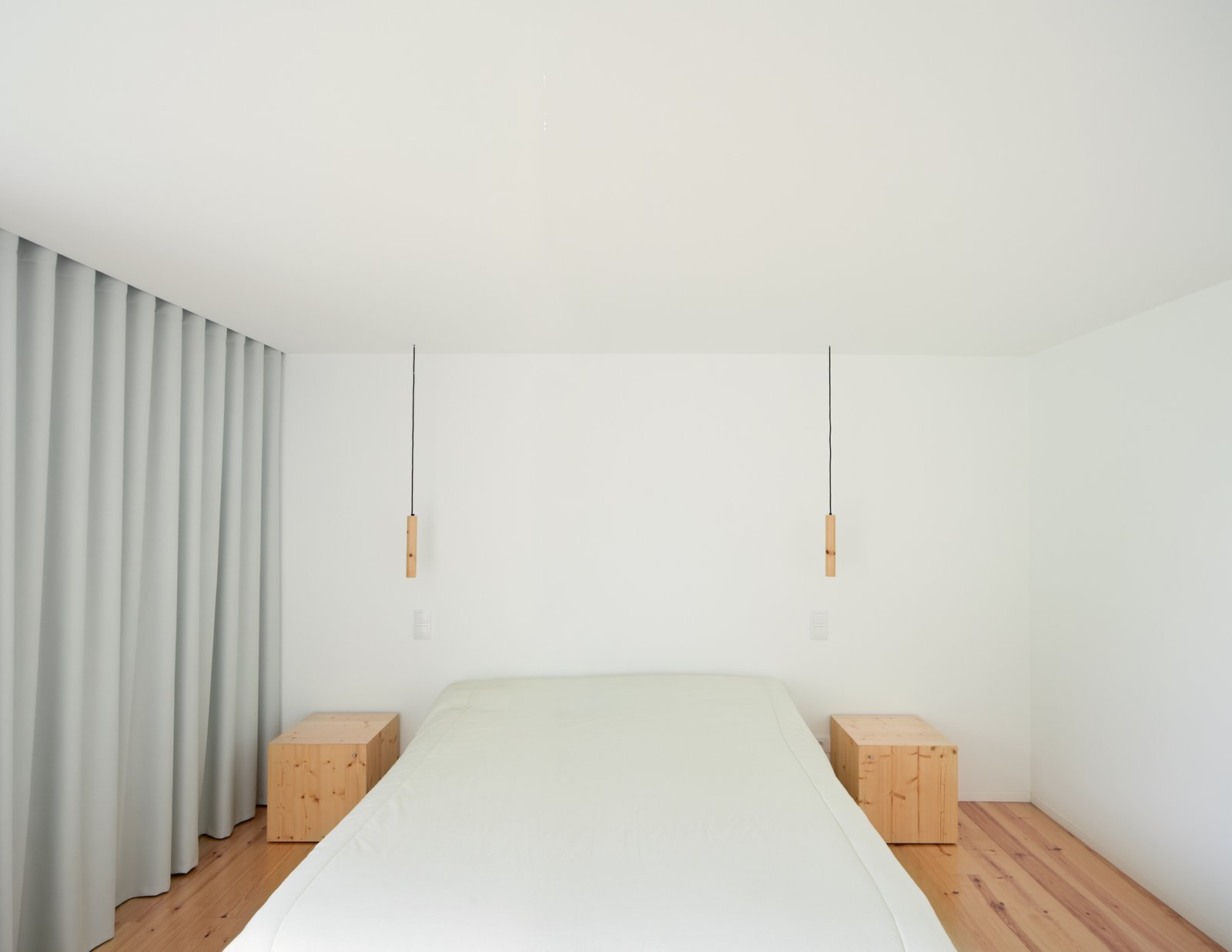 Tagged: Bedroom, Bed, Pendant Lighting, and Medium Hardwood Floor.  Fanu House by Bruno Lucas