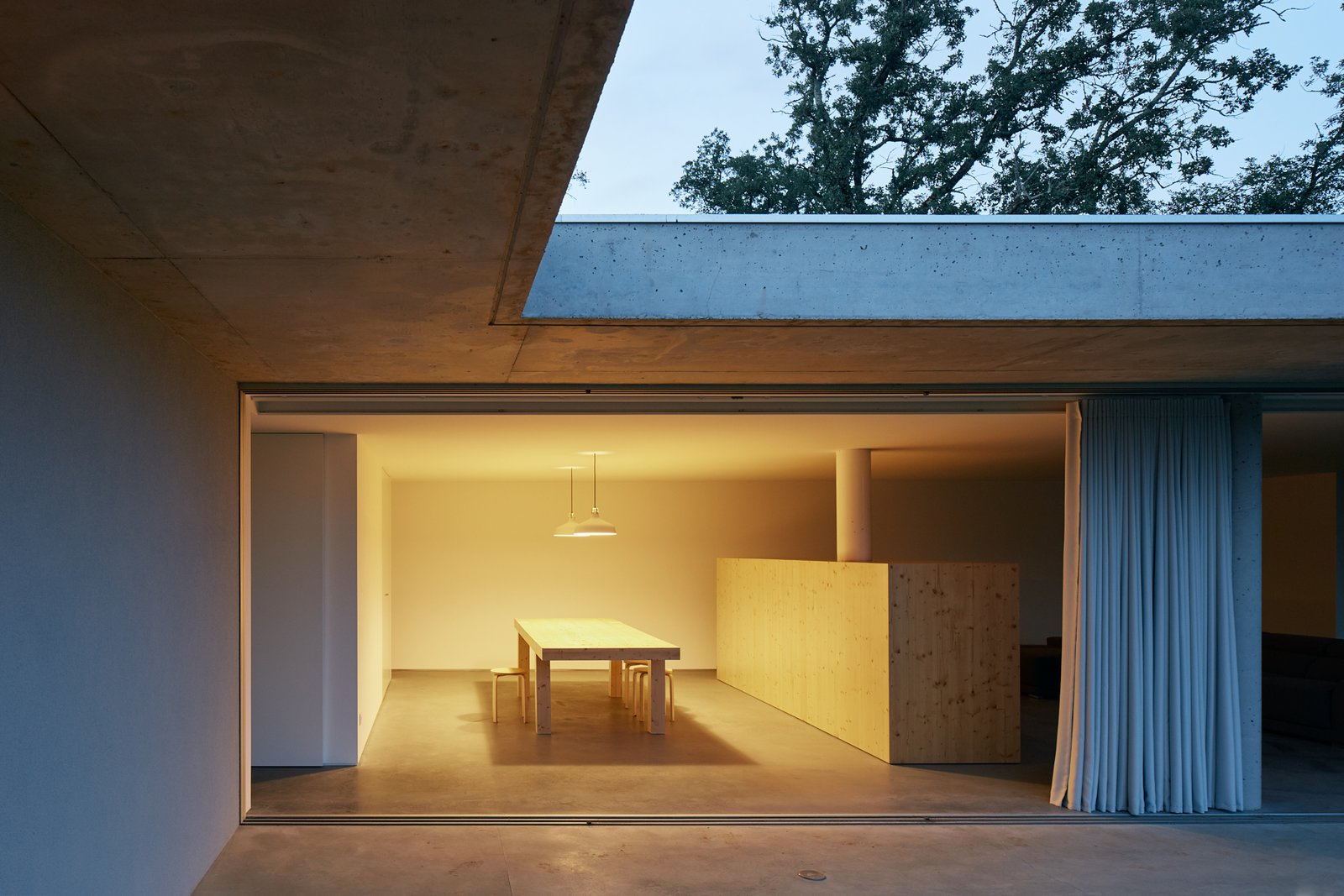 Tagged: Dining Room, Table, Lamps, Pendant Lighting, Concrete Floor, and Chair.  Fanu House by Bruno Lucas