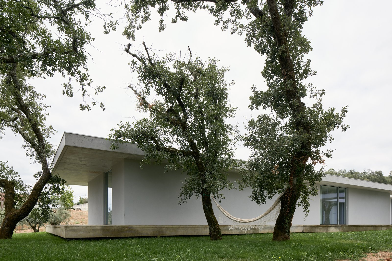 Tagged: Outdoor, Concrete Pools, Tubs, Shower, and Grass.  Fanu House by Bruno Lucas