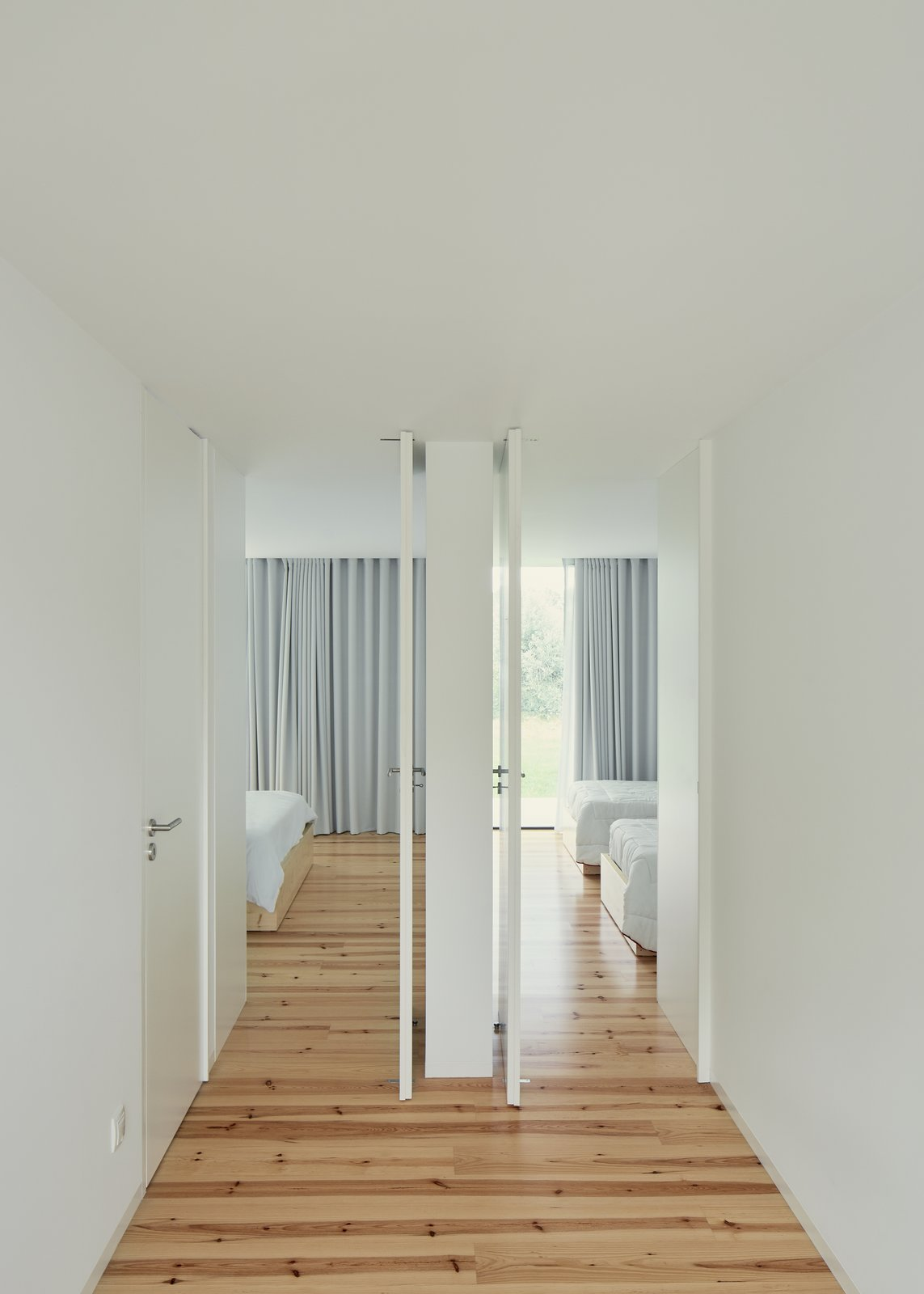 Tagged: Bedroom, Bed, and Medium Hardwood Floor.  Fanu House by Bruno Lucas