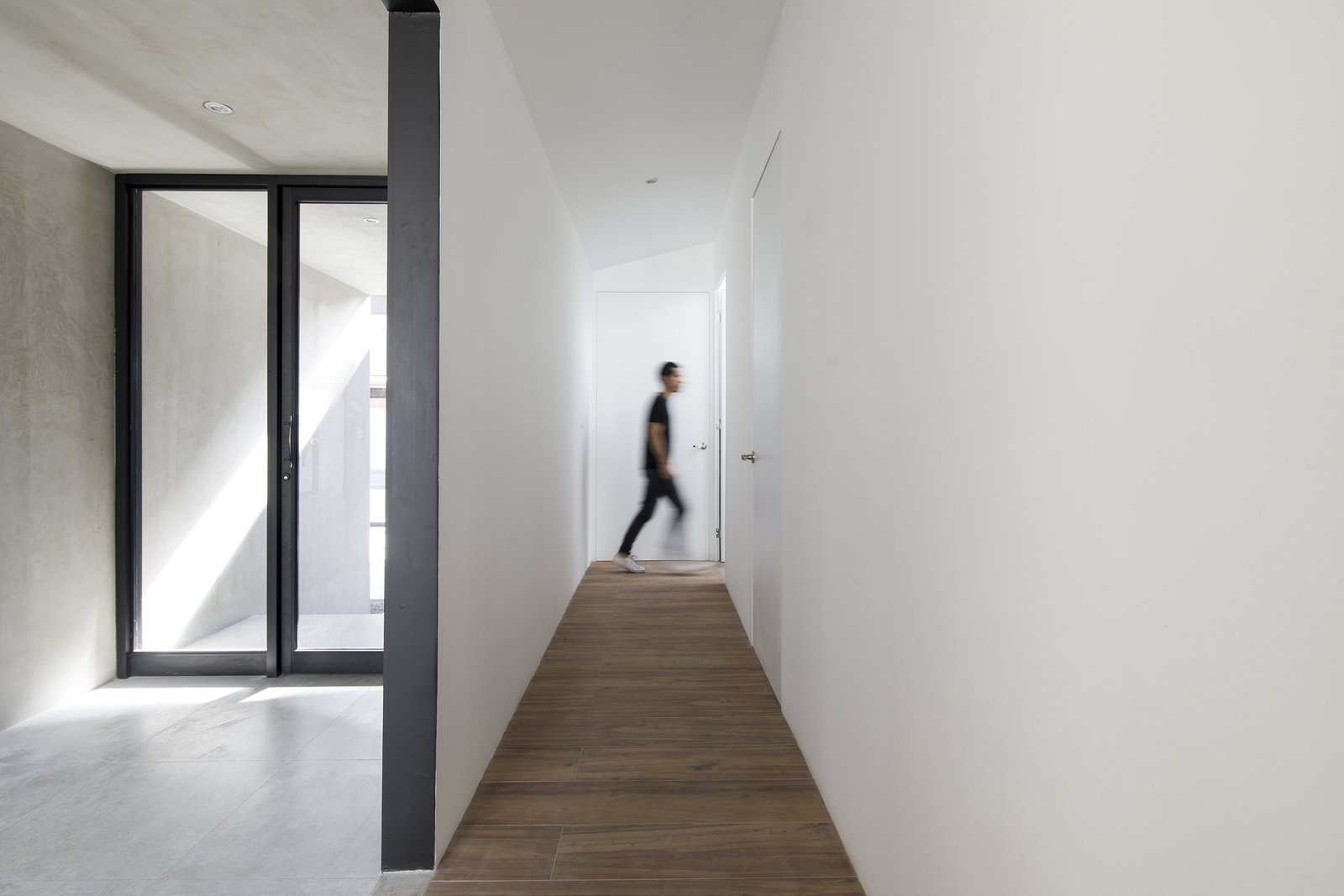 Tagged: Hallway and Porcelain Tile Floor.  Photo 4 of 5 in Top 4 Homes of the Week That Celebrate Earth Tones from Casa Ching