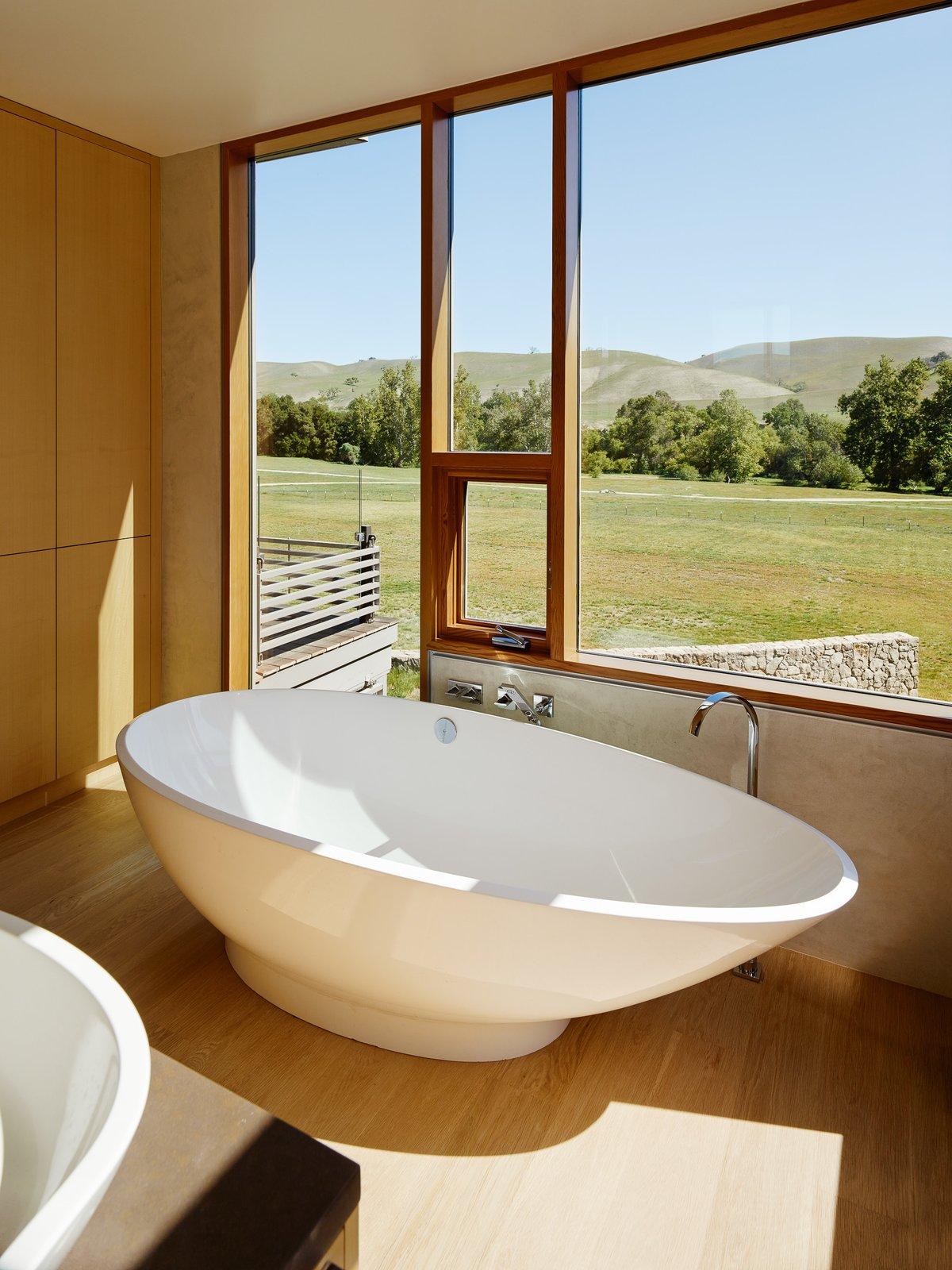 Tagged: Bath Room, Light Hardwood Floor, Freestanding Tub, and Vessel Sink.  Spring Ranch by Feldman Architecture