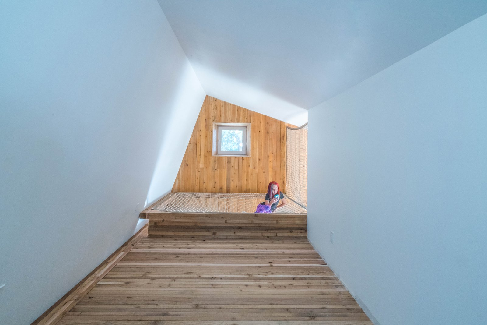 Tagged: Light Hardwood Floor, Bedroom, Teen Age, Bed, Neutral Gender, and Bedroom.  MARTaK Passive House by Baosol Design