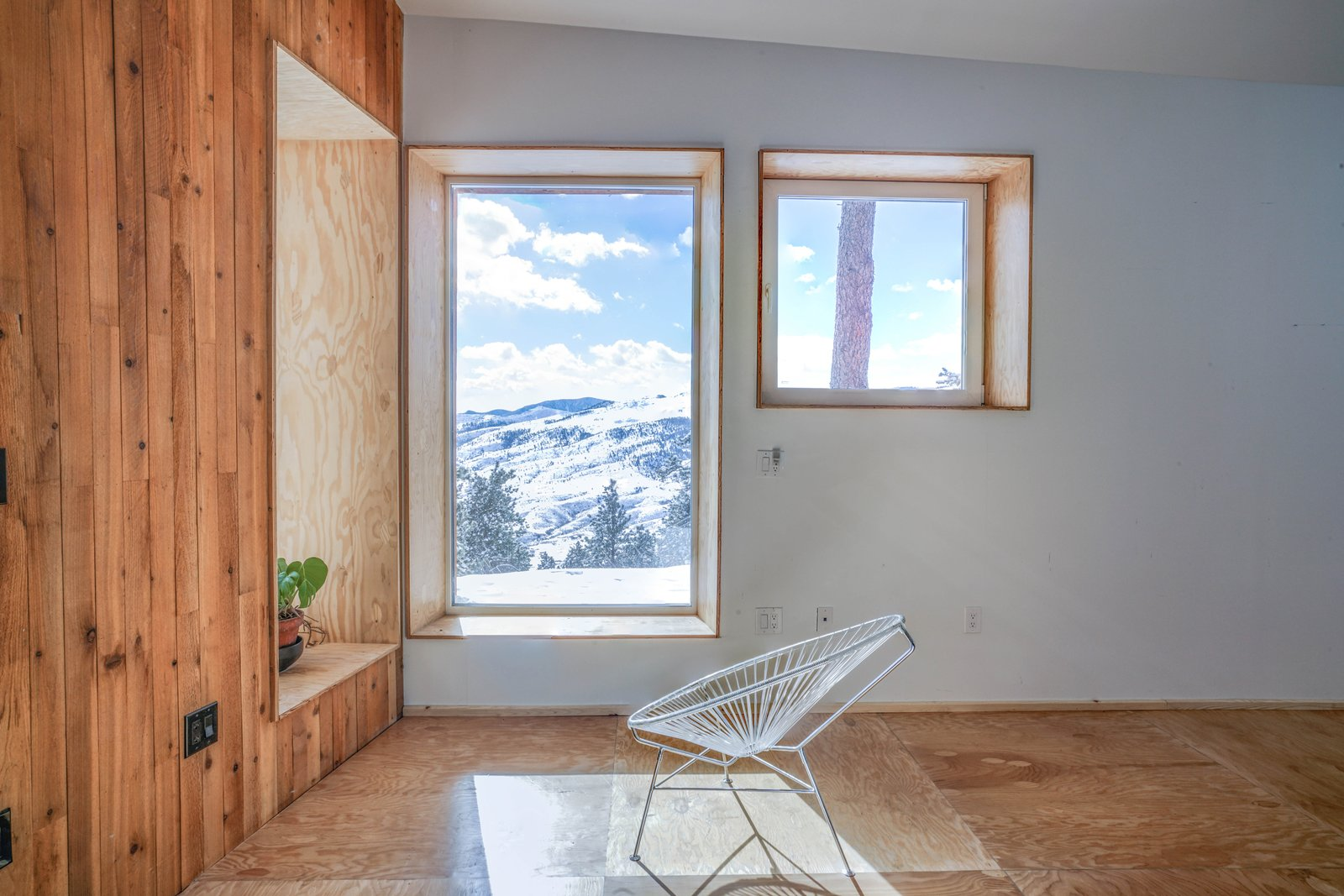 Tagged: Chair, Light Hardwood Floor, Windows, Picture Window Type, and Vinyl.  MARTaK Passive House by Baosol Design