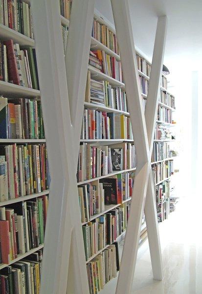 Bookcase behind structural prefab truss
