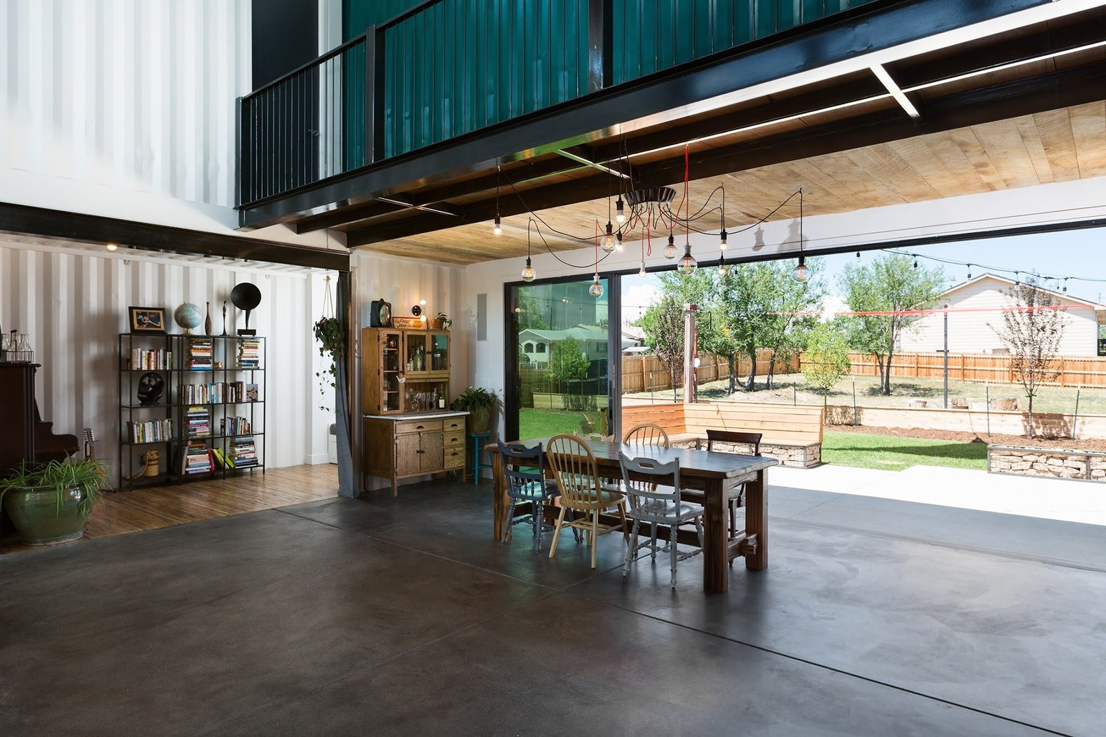 Chris Boylen Photography Tagged: Dining Room, Ceiling Lighting, Table, and Bench.  The Container house by regan foster
