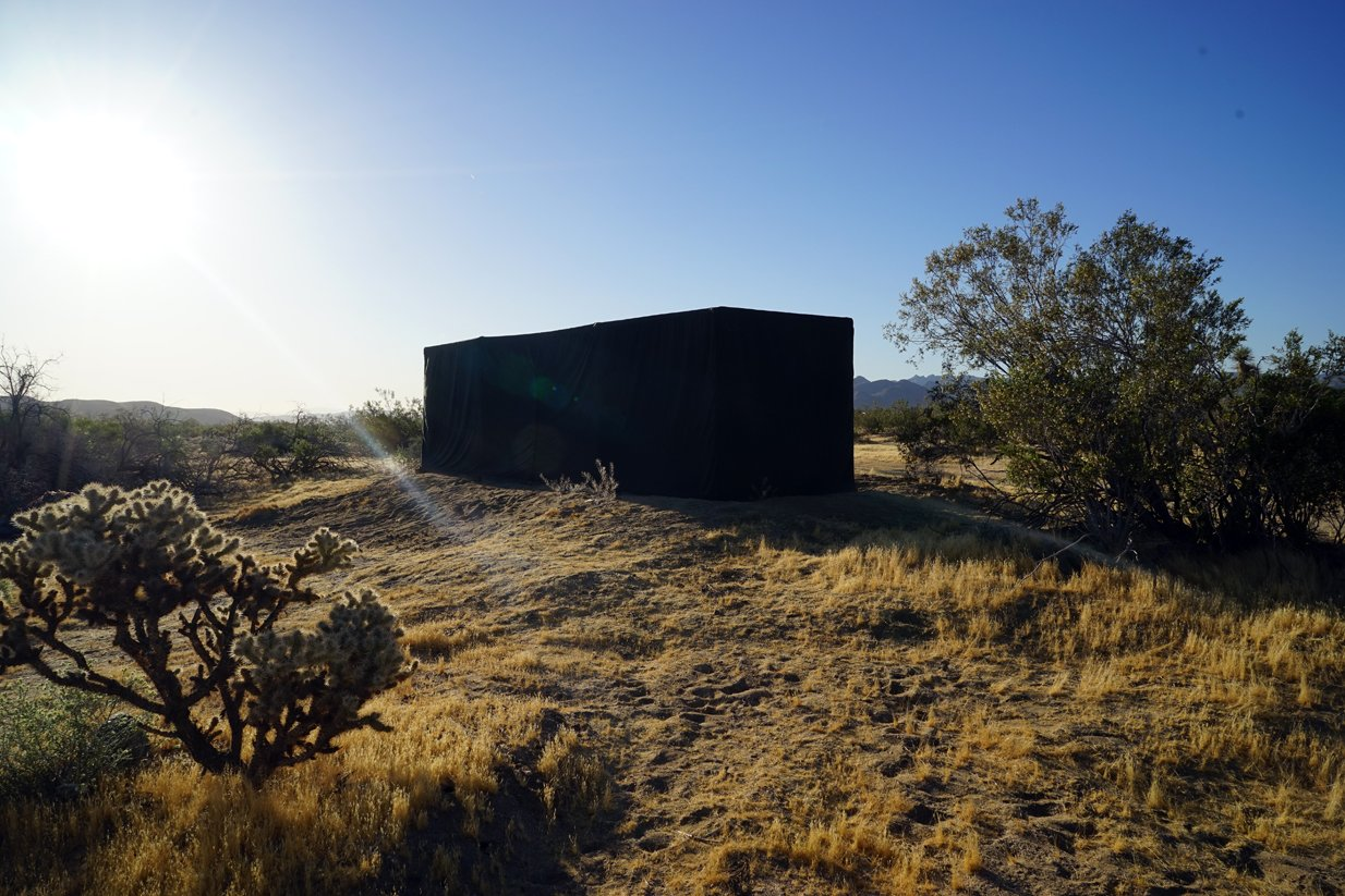 Cabin at dawn in fully closed configuration.   Joshua Tree Case Study Cabin by Mike Vensel