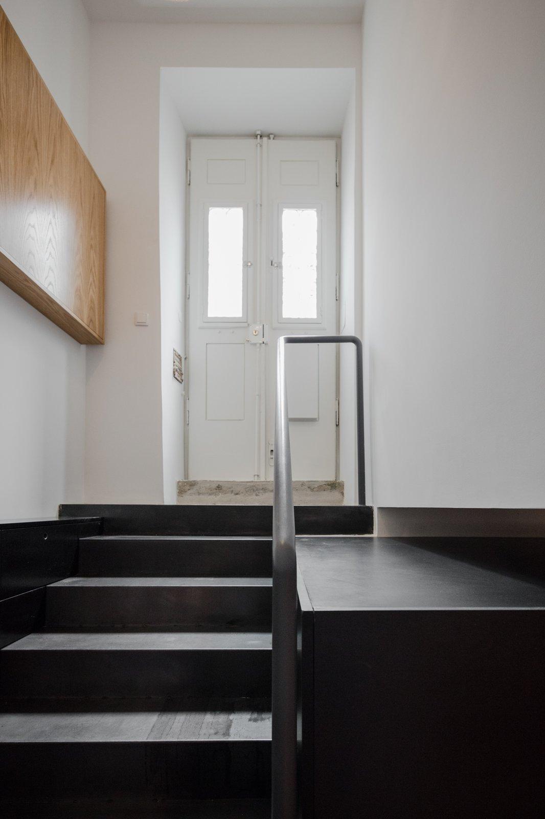 Tagged: Staircase, Metal Railing, and Metal Tread.  Rua Maria Loft by KEMA studio