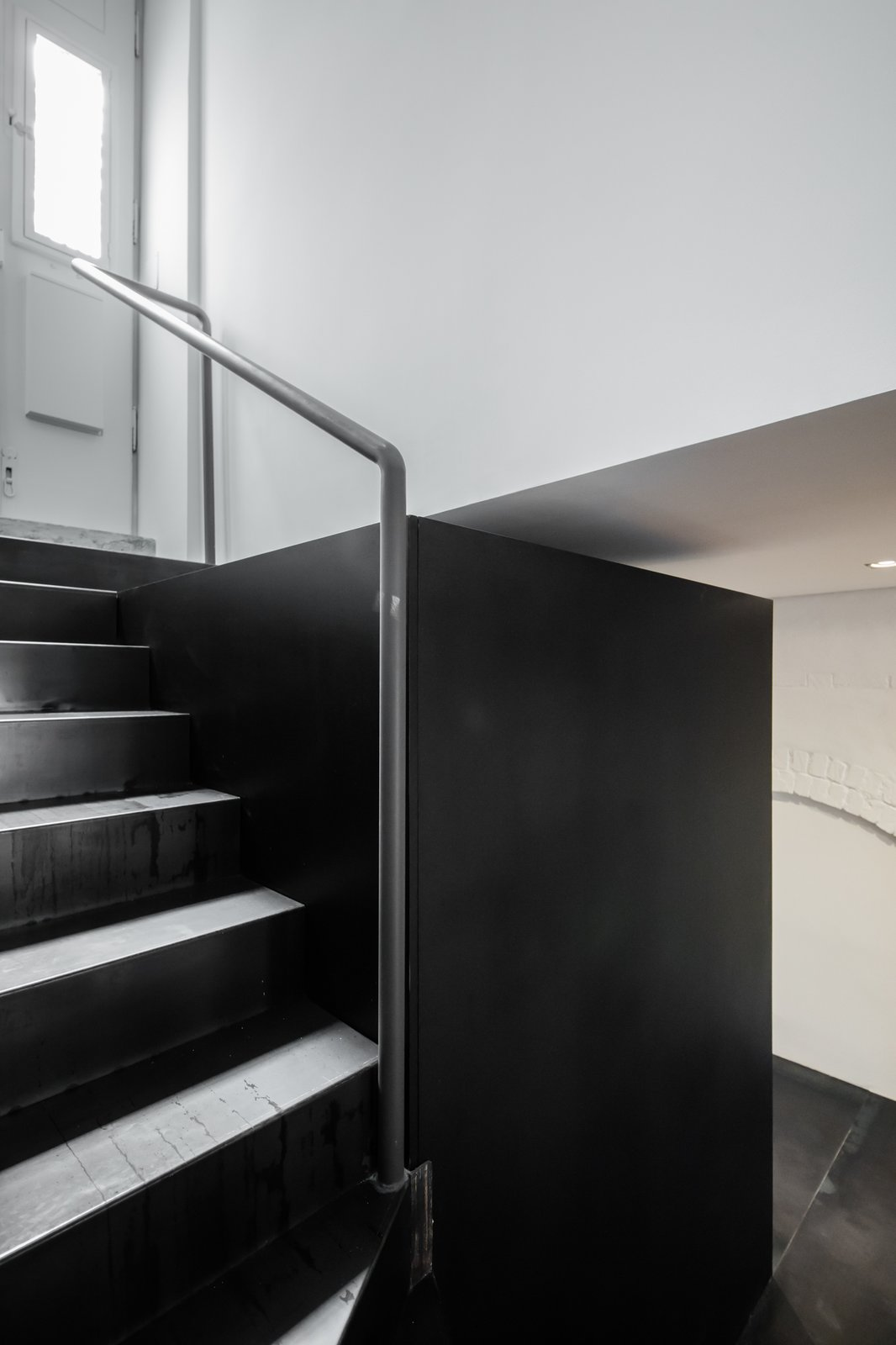 Tagged: Staircase, Metal Tread, and Metal Railing.  Rua Maria Loft by KEMA studio