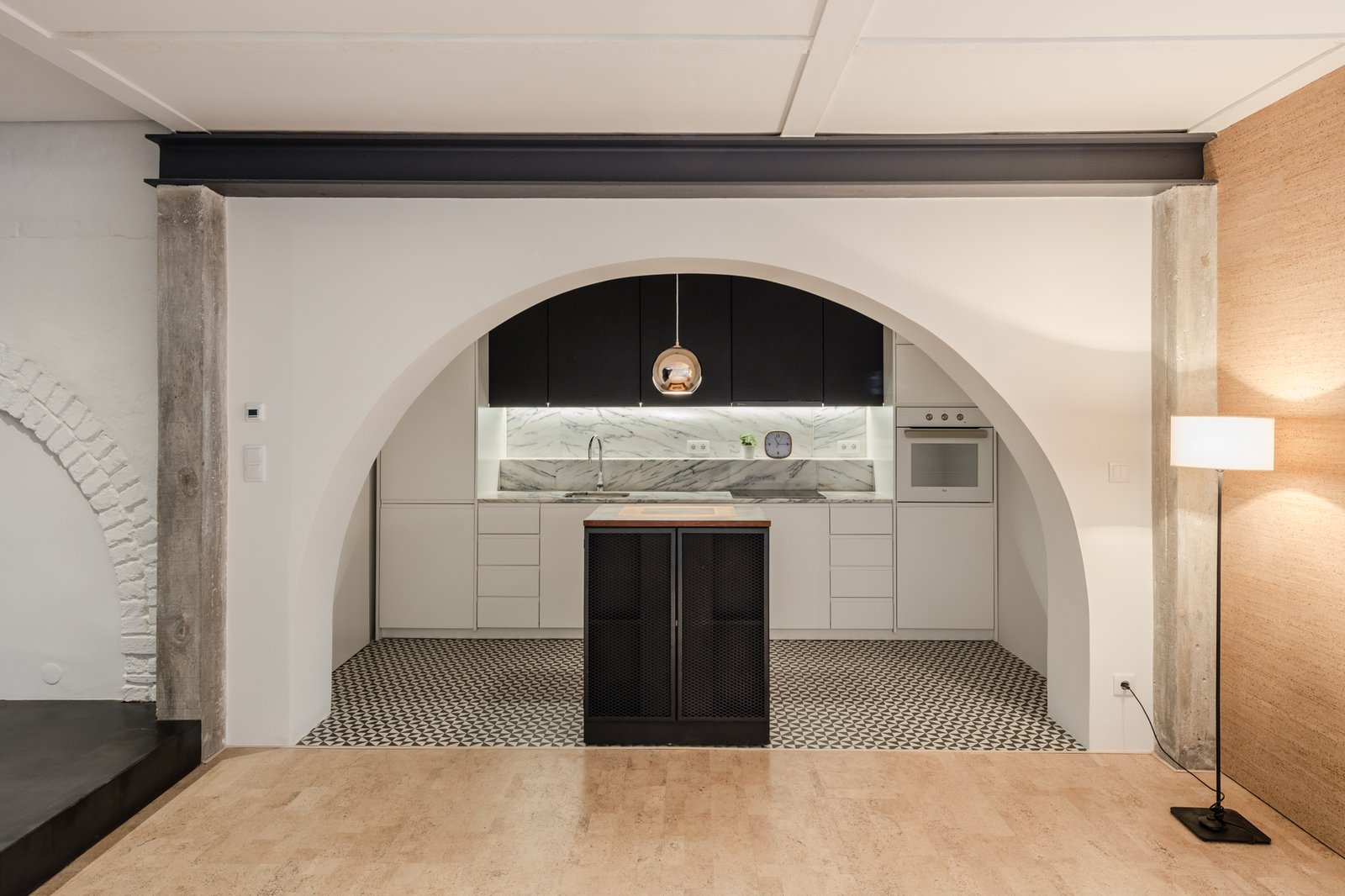 Tagged: Kitchen, Marble Counter, White Cabinet, Ceramic Tile Floor, Wall Oven, Undermount Sink, Marble Backsplashe, and Pendant Lighting.  Rua Maria Loft by KEMA studio