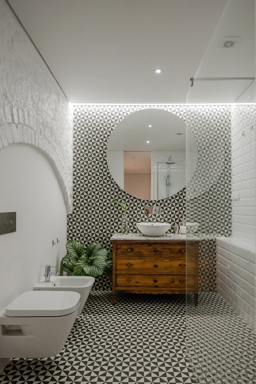 Tagged: Bath Room, Marble Counter, Ceramic Tile Floor, Ceramic Tile Wall, One Piece Toilet, Recessed Lighting, and Vessel Sink.  Rua Maria Loft by KEMA studio