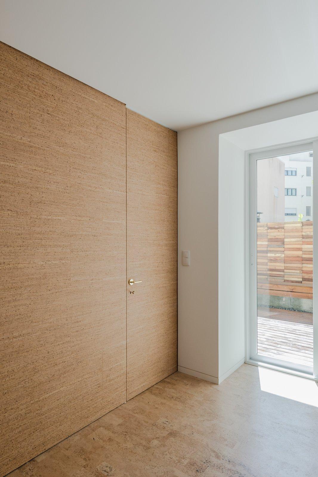 Tagged: Living Room, Cork Floor, and Ceiling Lighting. Rua Maria Loft by KEMA studio