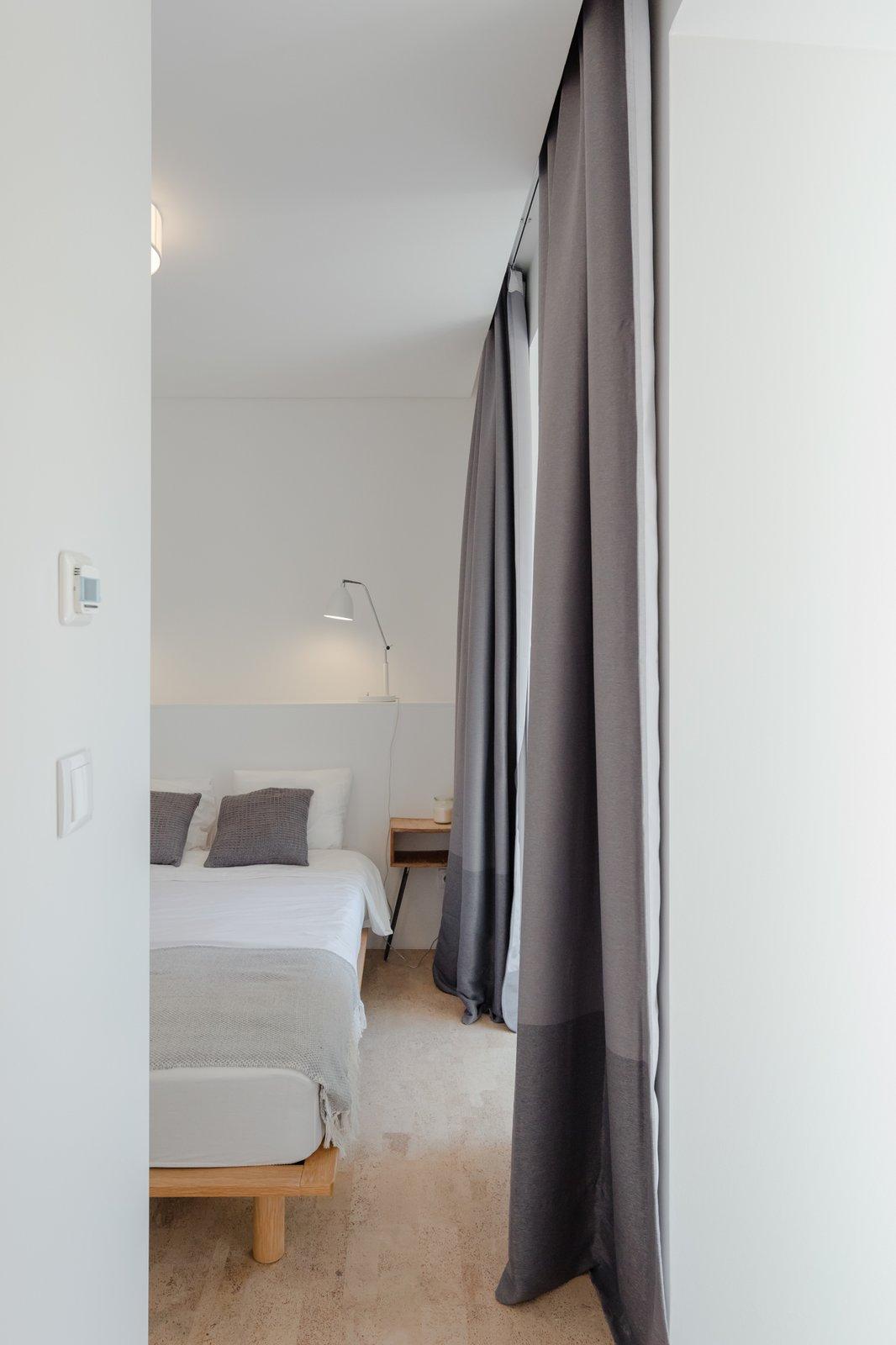 Tagged: Bedroom, Night Stands, Bed, and Cork Floor.  Rua Maria Loft by KEMA studio