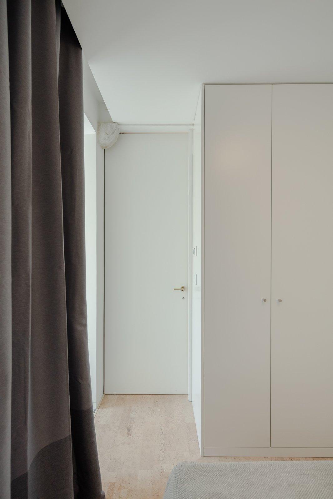 Tagged: Bedroom, Wardrobe, and Cork Floor.  Rua Maria Loft by KEMA studio