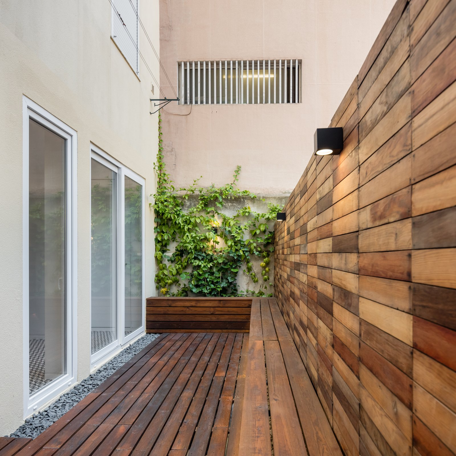 Tagged: Outdoor, Back Yard, Small Patio, Porch, Deck, Trees, Boulders, Wood Patio, Porch, Deck, and Hanging Lighting.  Rua Maria Loft by KEMA studio