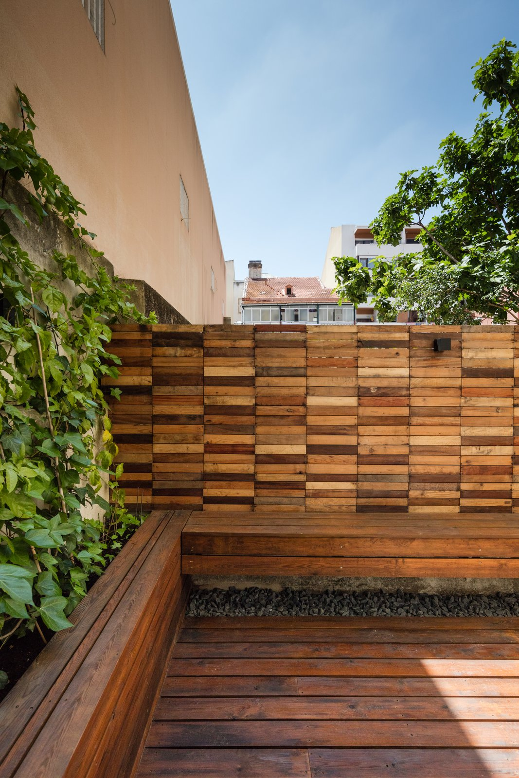 Tagged: Outdoor, Back Yard, Wood Patio, Porch, Deck, Small Patio, Porch, Deck, Horizontal Fences, Wall, and Wood Fences, Wall.  Rua Maria Loft by KEMA studio