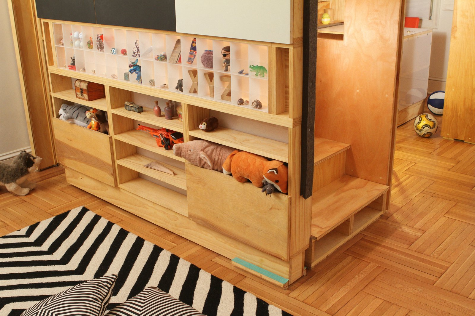 Close-up stair to sleeping loft with storage compartments, including back-lit acrylic display box Tagged: Kids, Bedroom, Playroom, Storage, Shelves, Bookcase, Medium Hardwood, Pre-Teen, Boy, and Neutral.  Best Kids Pre-Teen Medium Hardwood Photos from LO Residence Playroom/Bedroom