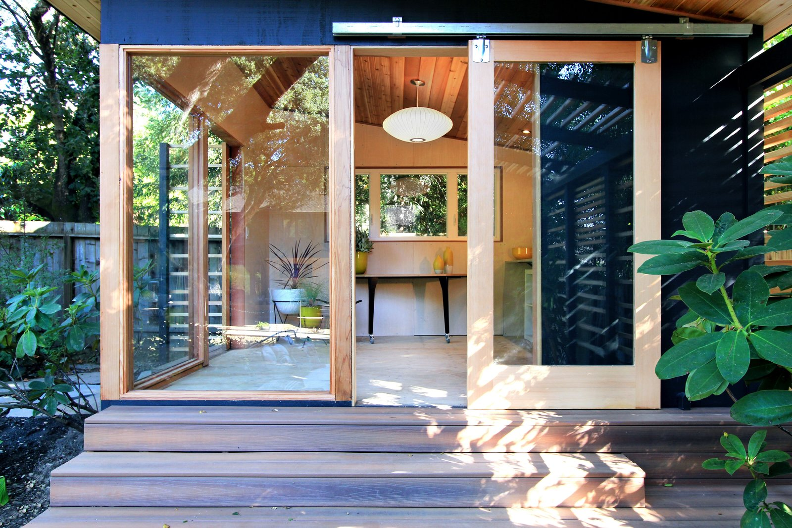 The Shudio exterior and interior.  Tagged: Boulders, Wood Patio, Porch, Deck, Hanging Lighting, Landscape Lighting, Horizontal Fences, Wall, and Kids Room.  The Shudio by Melissa Hanley