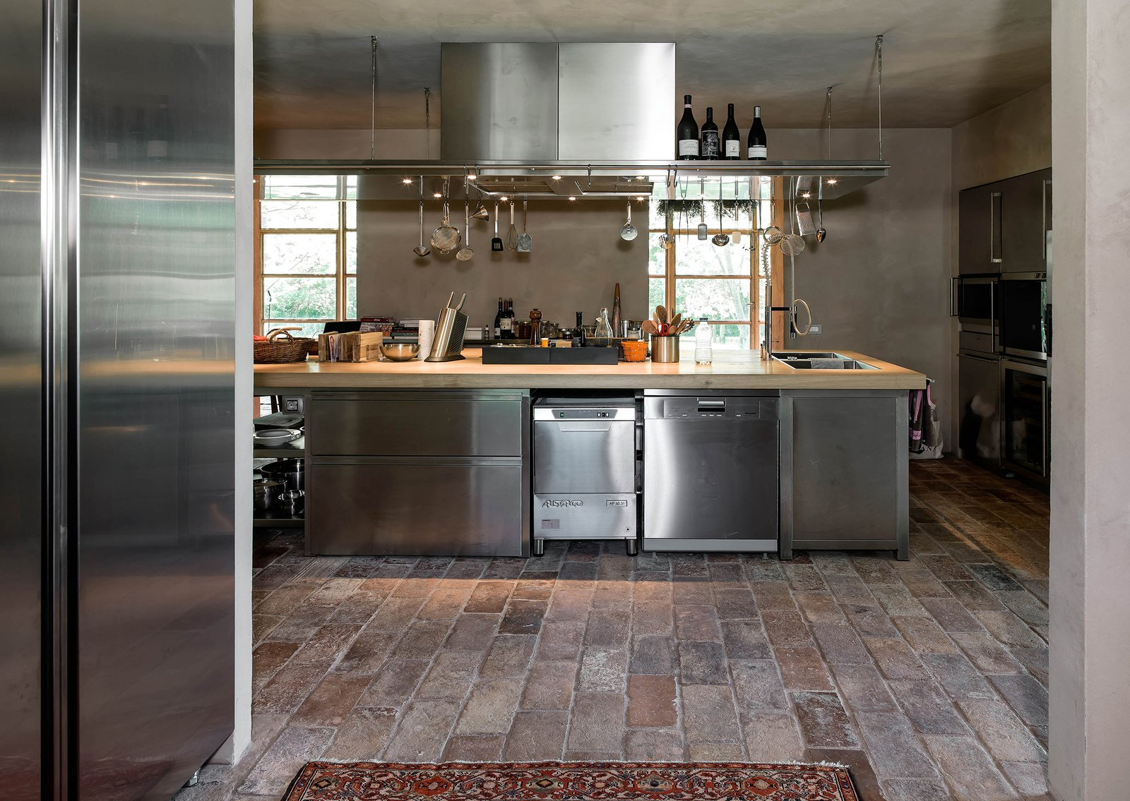Tagged: Kitchen, Wood Counter, Metal Cabinet, Laminate Cabinet, Cooktops, and Dishwasher.  Country House by zanon architetti associati