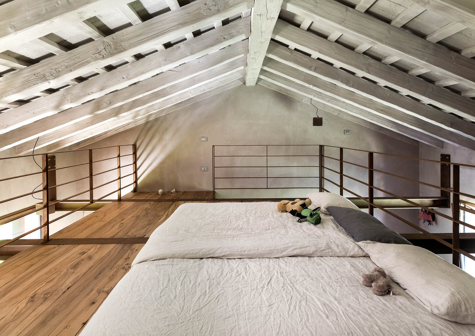 Tagged: Bedroom, Bed, Ceiling Lighting, and Medium Hardwood Floor.  Country House by zanon architetti associati