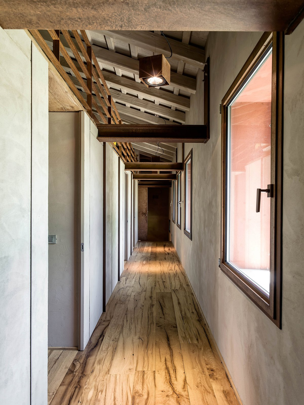 Tagged: Hallway and Medium Hardwood Floor.  Country House by zanon architetti associati