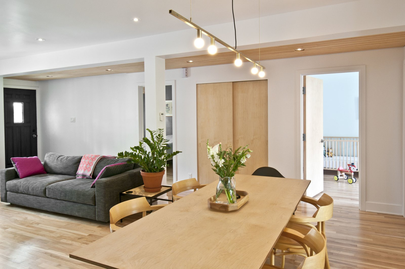 Tagged: Dining Room, Pendant Lighting, Chair, Light Hardwood Floor, and Table.  Fabre Residence by Jonathan Dorthe