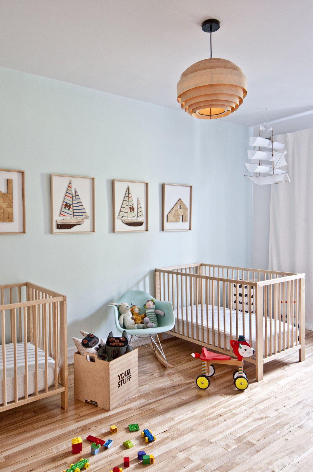 Tagged: Kids Room, Light Hardwood Floor, Bedroom, Bed, Toddler Age, and Neutral Gender.  Fabre Residence by Jonathan Dorthe
