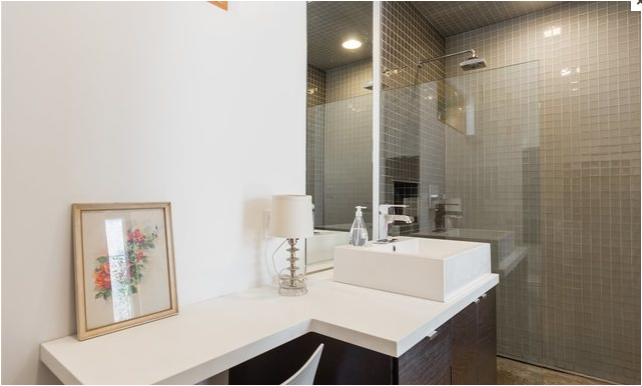 Lower Suite Bathroom Tagged: Bath Room, Vessel Sink, Open Shower, Concrete Floor, Corner Shower, Full Shower, Recessed Lighting, Glass Tile Wall, Ceiling Lighting, Table Lighting, and One Piece Toilet.  East Pender home by Linda Mitchell