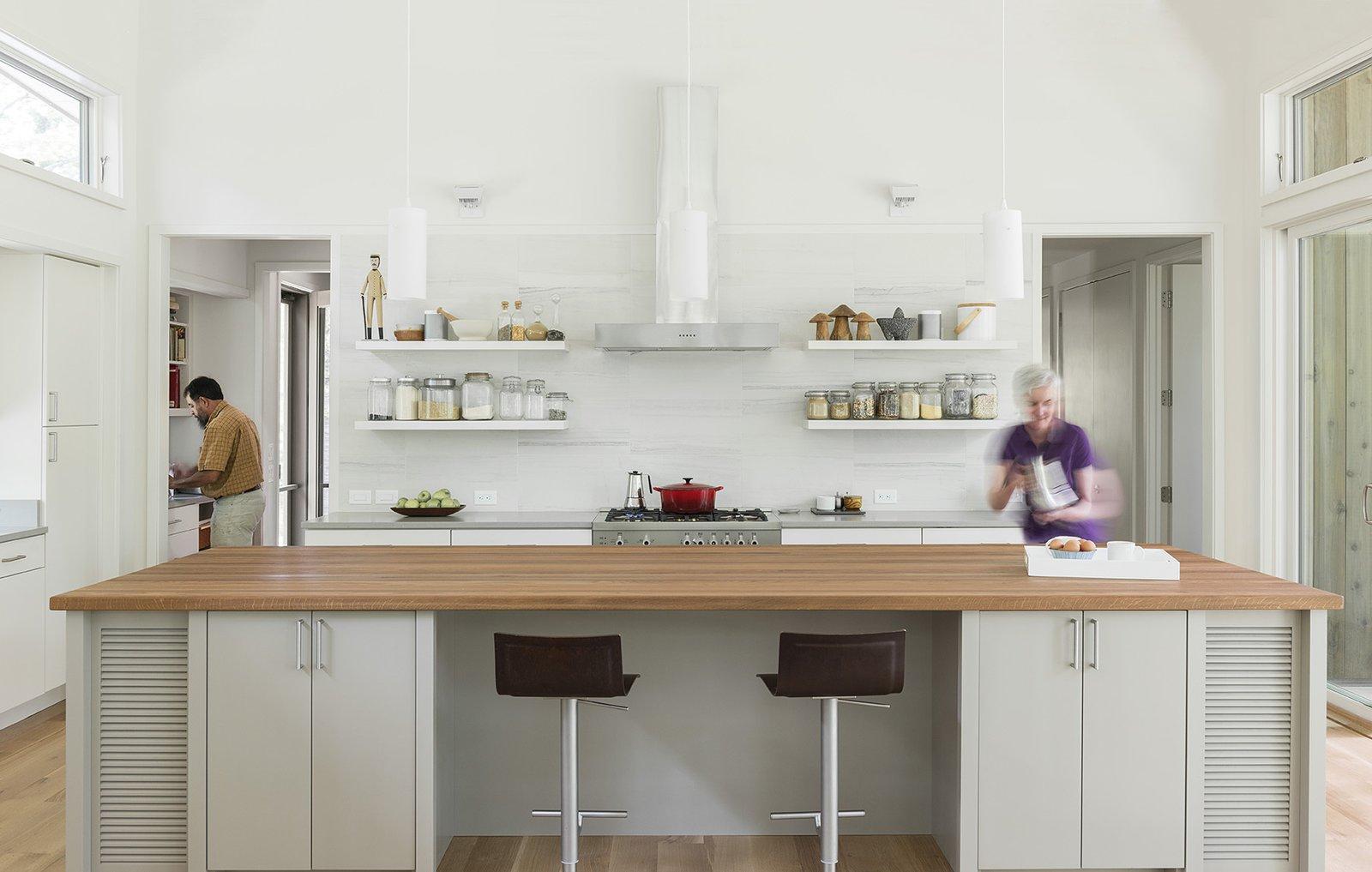 Tagged: Kitchen, White Cabinet, Wood Counter, Light Hardwood Floor, Range, Pendant Lighting, and Range Hood.  The Hammock House by Samsel Architects