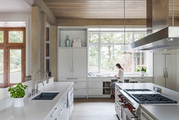 The kitchen has multiple islands for smart base cabinet storage which allows visual connection from the kitchen to all surrounding spaces.