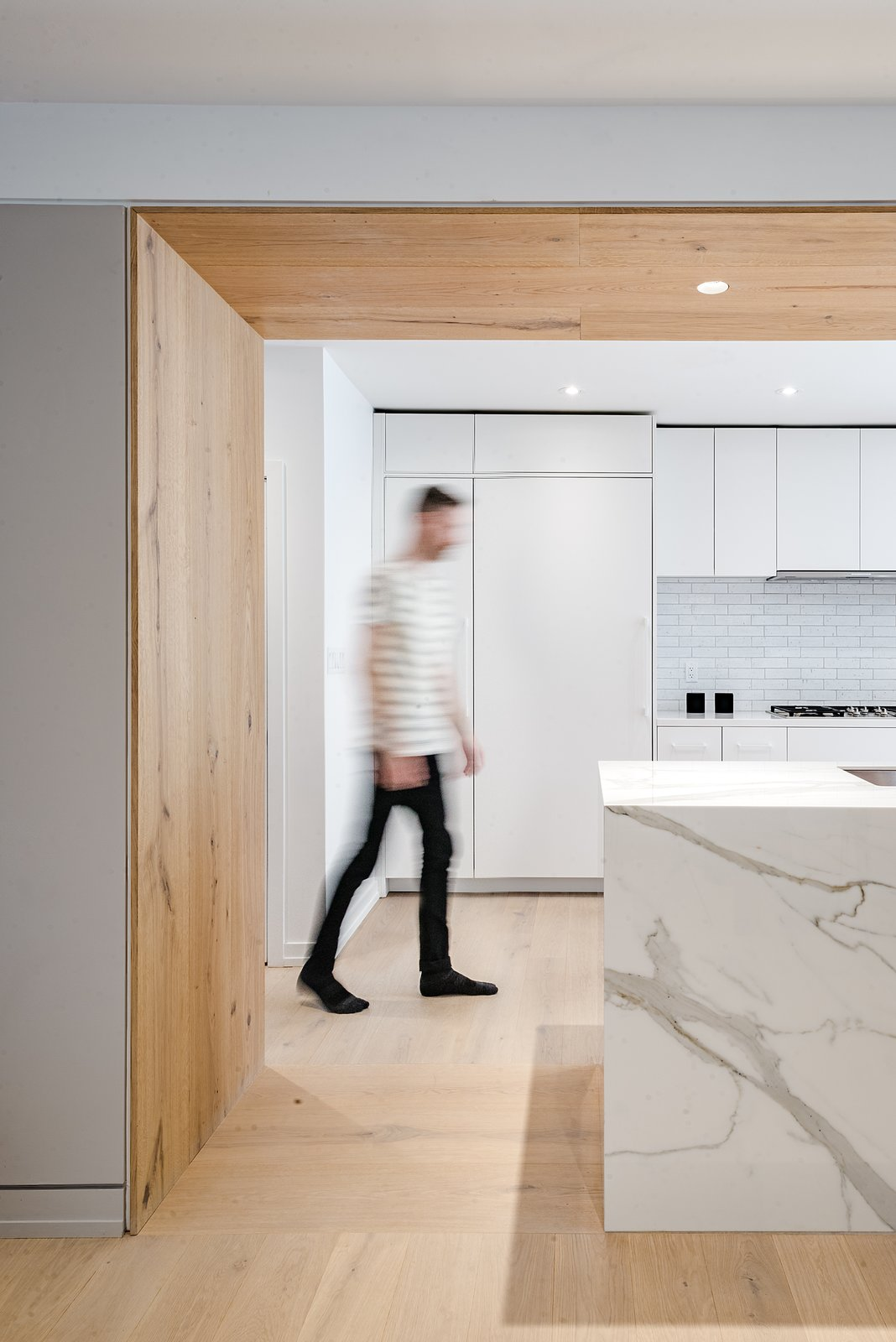 Tagged: Kitchen, Quartzite Counter, White Cabinet, Subway Tile Backsplashe, Ceiling Lighting, Recessed Lighting, Light Hardwood Floor, Refrigerator, and Undermount Sink.  Richview Residence by StudioAC
