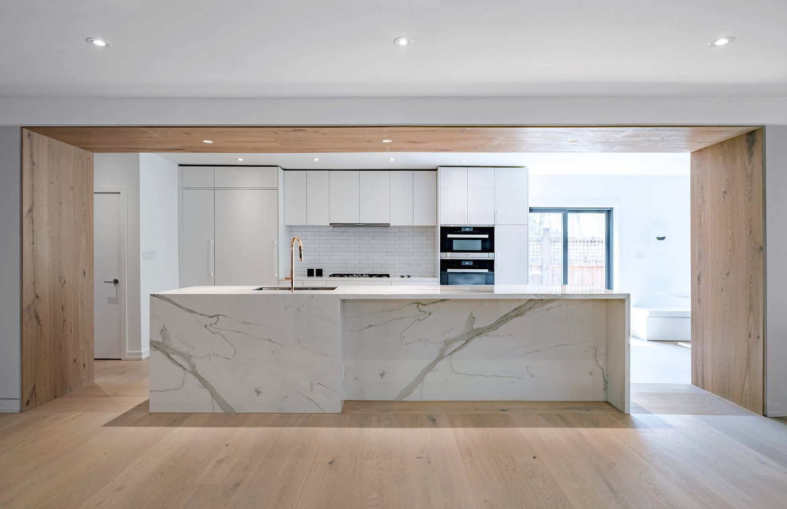 Tagged: Kitchen, White Cabinet, Subway Tile Backsplashe, Quartzite Counter, Light Hardwood Floor, Ceiling Lighting, Recessed Lighting, Refrigerator, Wall Oven, and Undermount Sink. Richview Residence by StudioAC