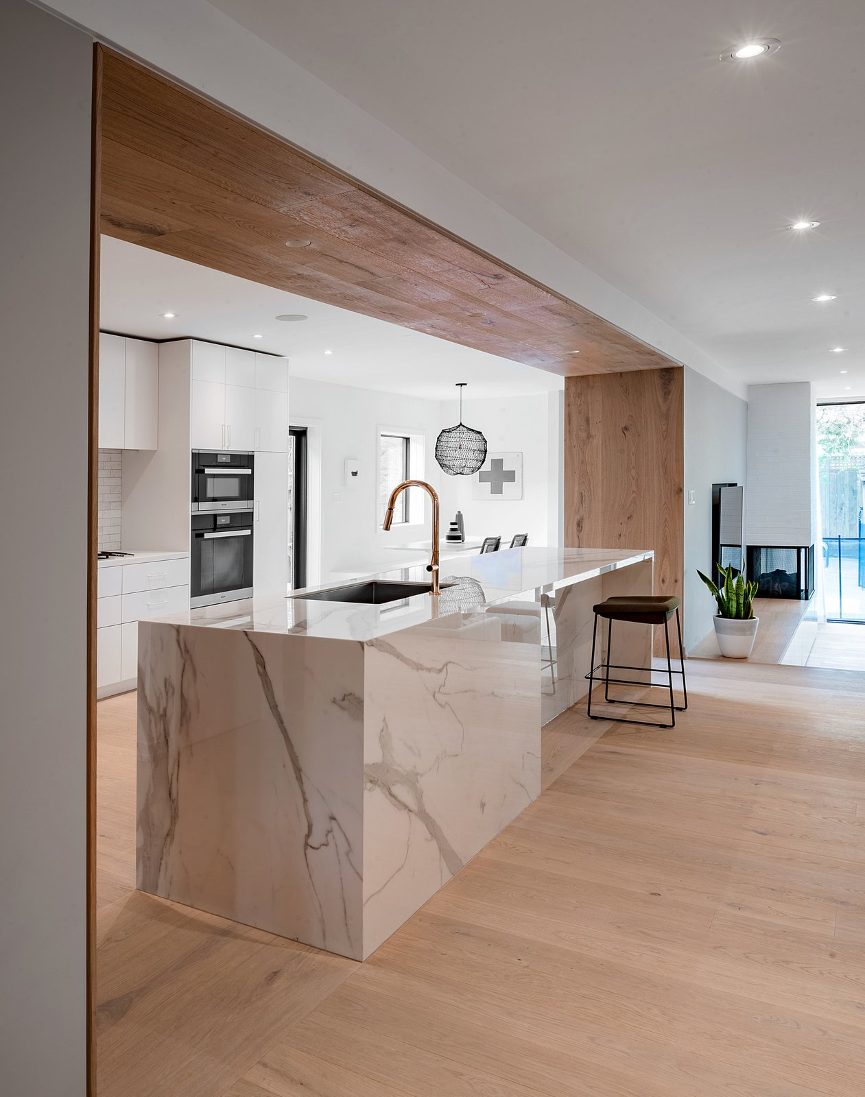 Tagged: Kitchen, Quartzite Counter, White Cabinet, Light Hardwood Floor, Ceiling Lighting, Subway Tile Backsplashe, Recessed Lighting, Undermount Sink, and Wall Oven.  Richview Residence by StudioAC