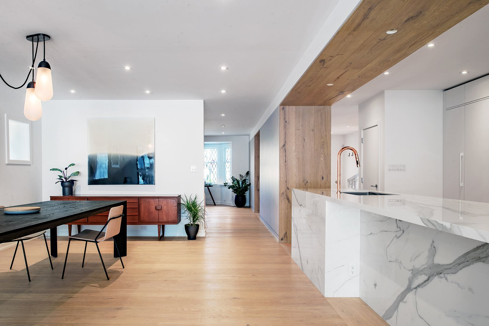 Tagged: Kitchen, Quartzite Counter, Light Hardwood Floor, White Cabinet, Subway Tile Backsplashe, Ceiling Lighting, Recessed Lighting, Undermount Sink, and Refrigerator.  Richview Residence by StudioAC