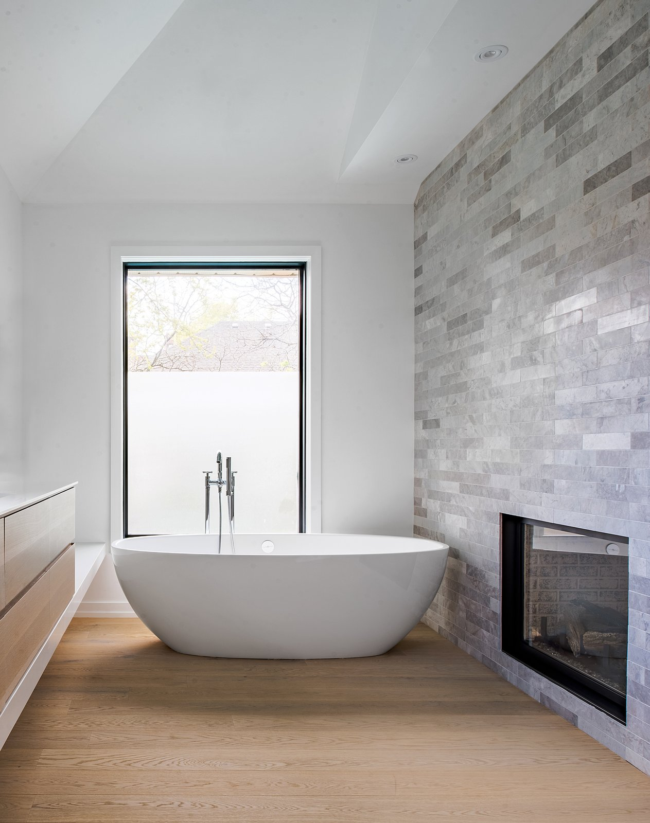 Tagged: Bath Room, Engineered Quartz Counter, Undermount Sink, Light Hardwood Floor, Freestanding Tub, Ceiling Lighting, Open Shower, Stone Tile Wall, and Soaking Tub. Richview Residence by StudioAC