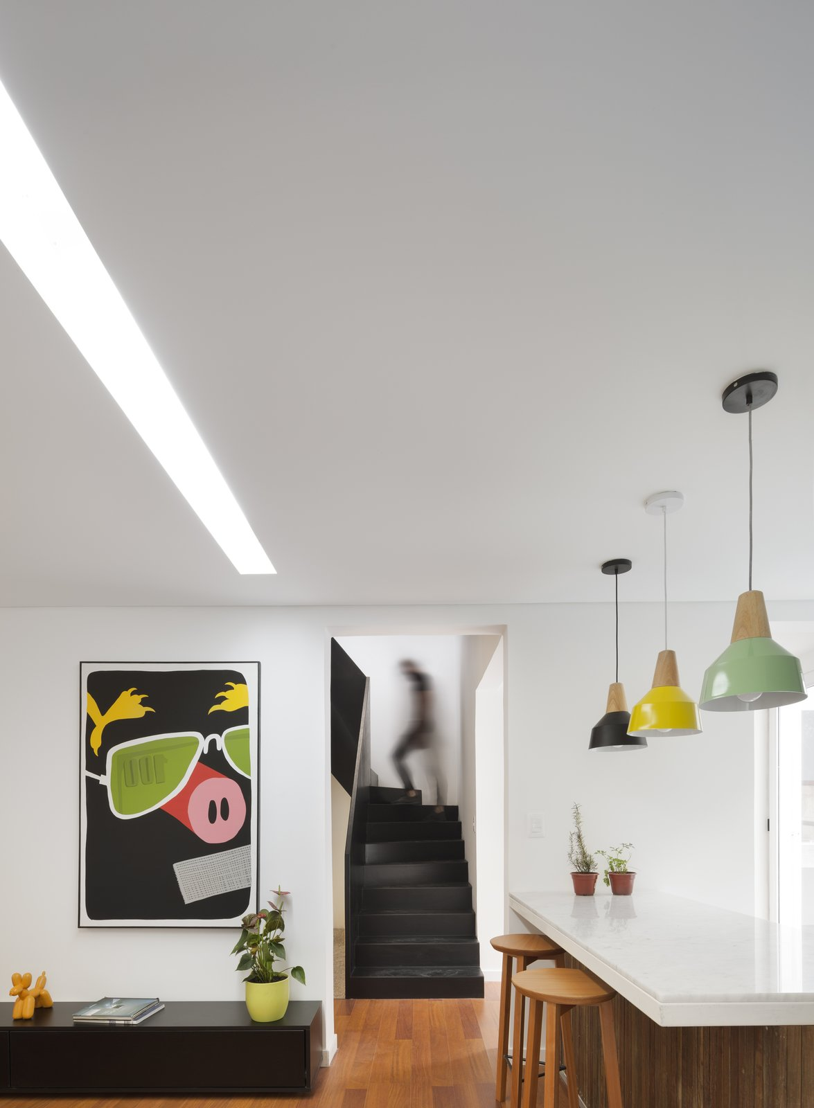 Interior Tagged: Kitchen, Marble Counter, Colorful Cabinet, Medium Hardwood Floor, Pendant Lighting, and Ceiling Lighting. Casa Plaza by mass arquitectos