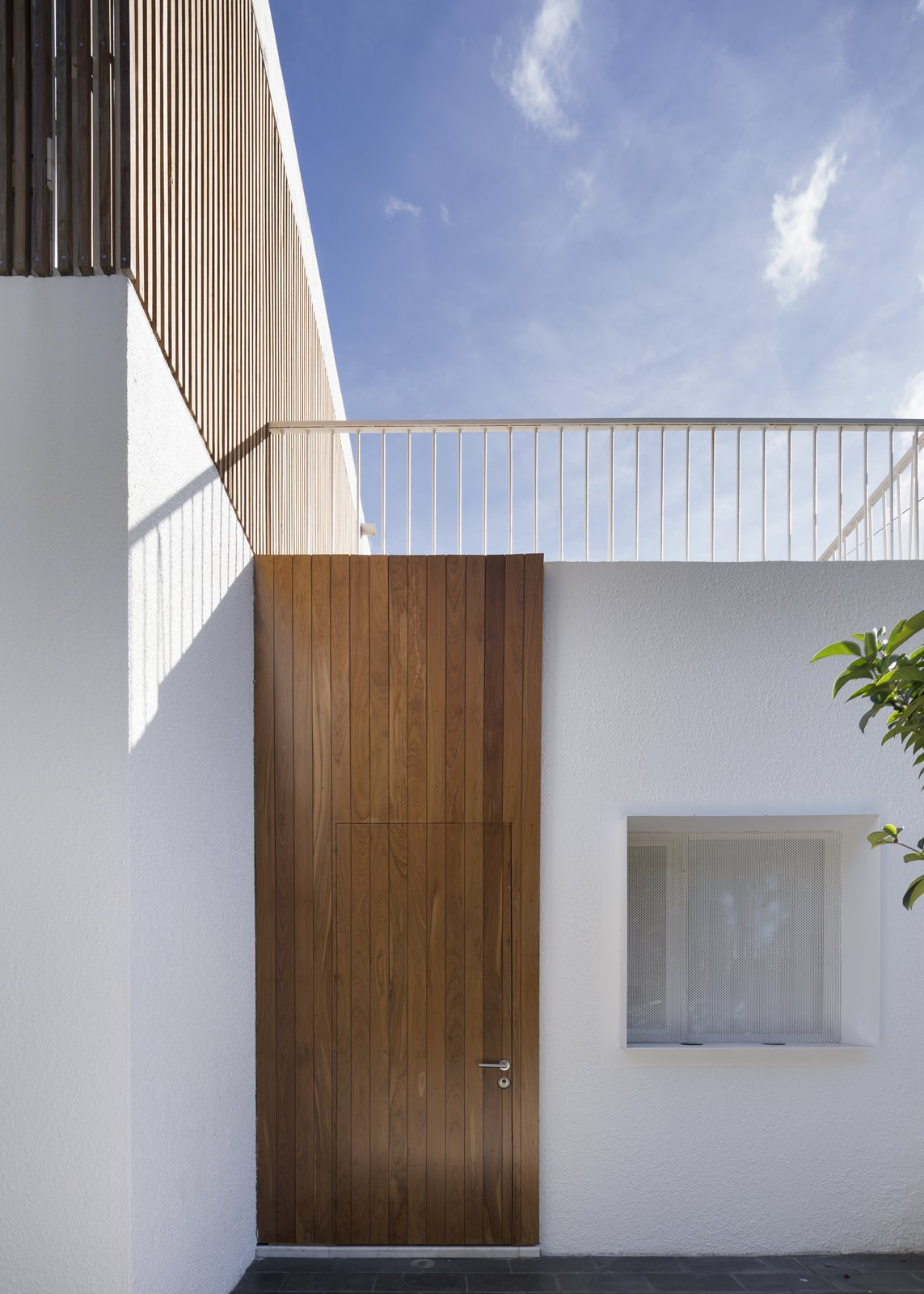 Access Tagged: Doors, Exterior, Swing Door Type, and Wood.  Casa Plaza by mass arquitectos