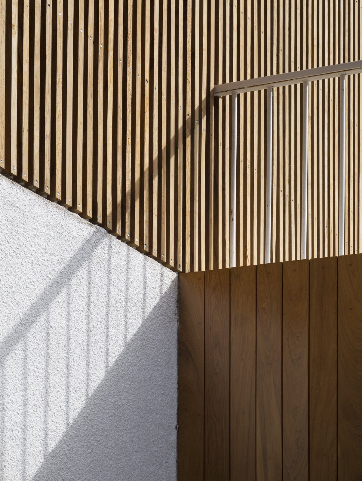 Detail Tagged: Outdoor, Vertical Fence, Wood Patio, Porch, Deck, Wood Fence, Concrete Patio, Porch, Deck, and Front Yard. Casa Plaza by mass arquitectos