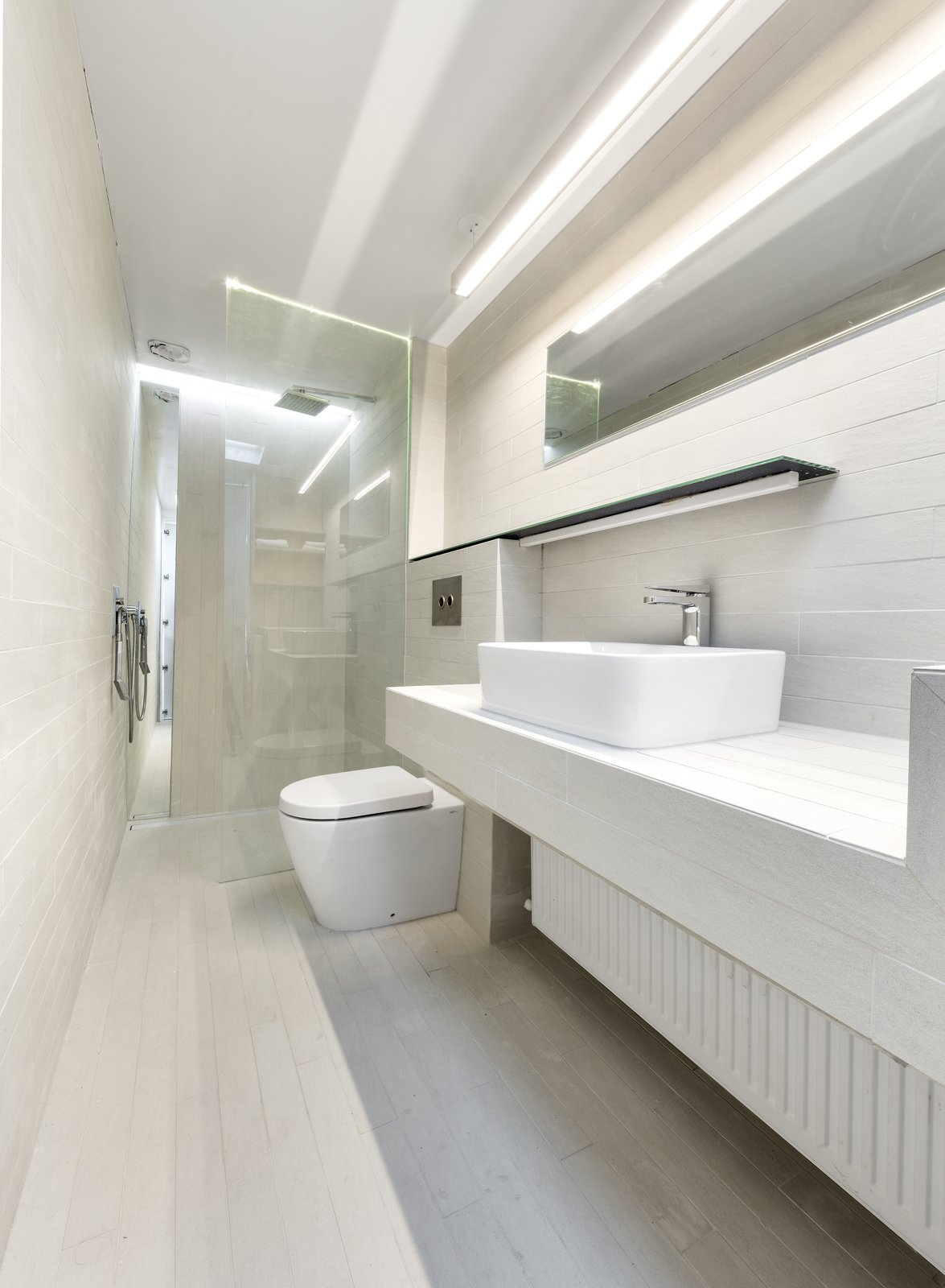Bathroom Tagged: Bath Room, Tile Counter, Porcelain Tile Floor, Vessel Sink, Open Shower, Ceiling Lighting, Accent Lighting, Pendant Lighting, Porcelain Tile Wall, One Piece Toilet, and Recessed Lighting.  Curtain Cottage by Otto Henkell