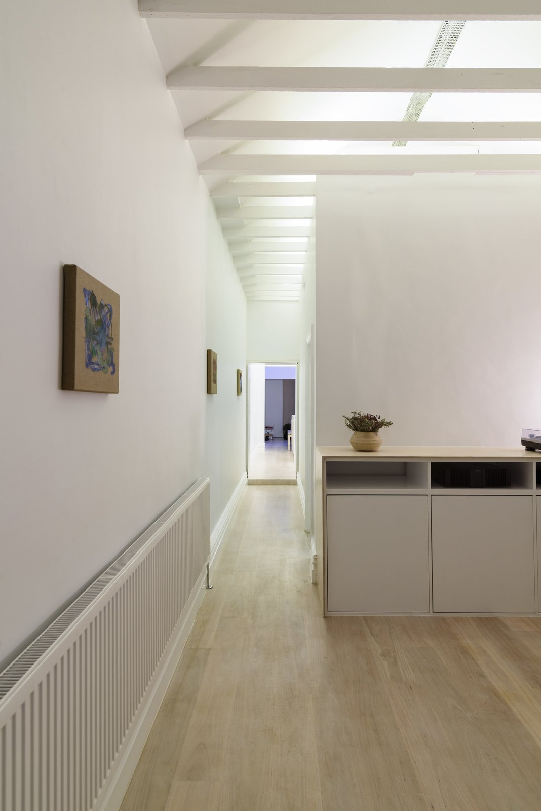 Corridor (Night) Tagged: Light Hardwood Floor, Ceiling Lighting, Recessed Lighting, Console Tables, and Living Room.  Curtain Cottage by Otto Henkell