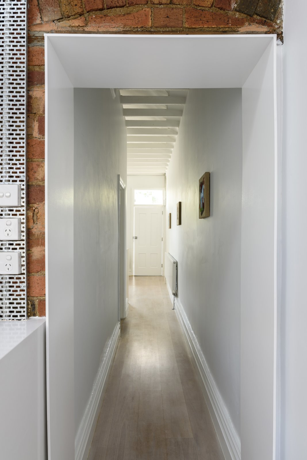 Threshold Tagged: Light Hardwood Floor, Kitchen, and Engineered Quartz Counter.  Curtain Cottage by Otto Henkell