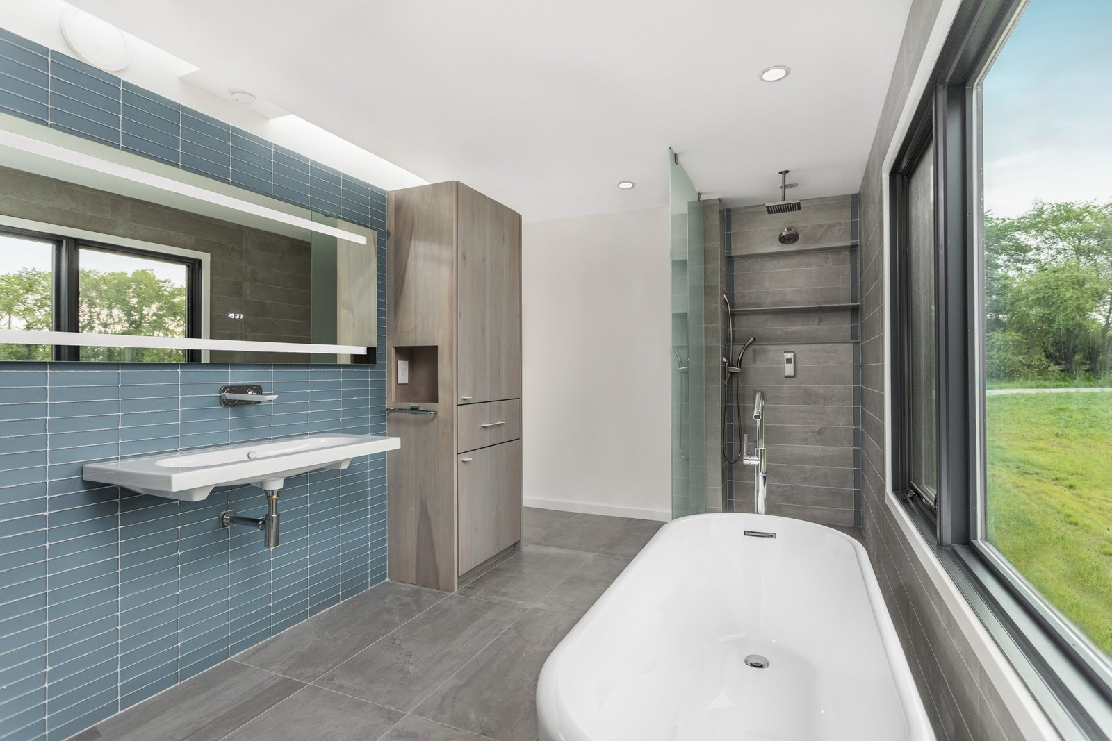 The modern bathroom with an open shower and simple tile.