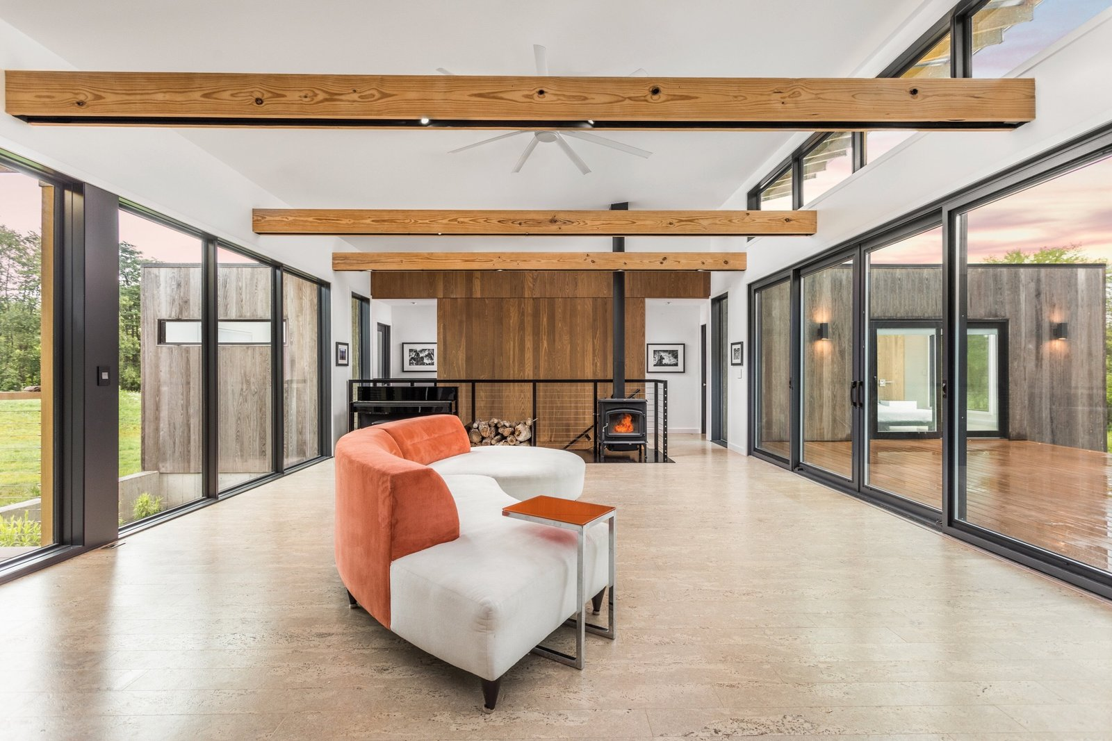 The main living space features north and south window walls. The flooring is cork.
