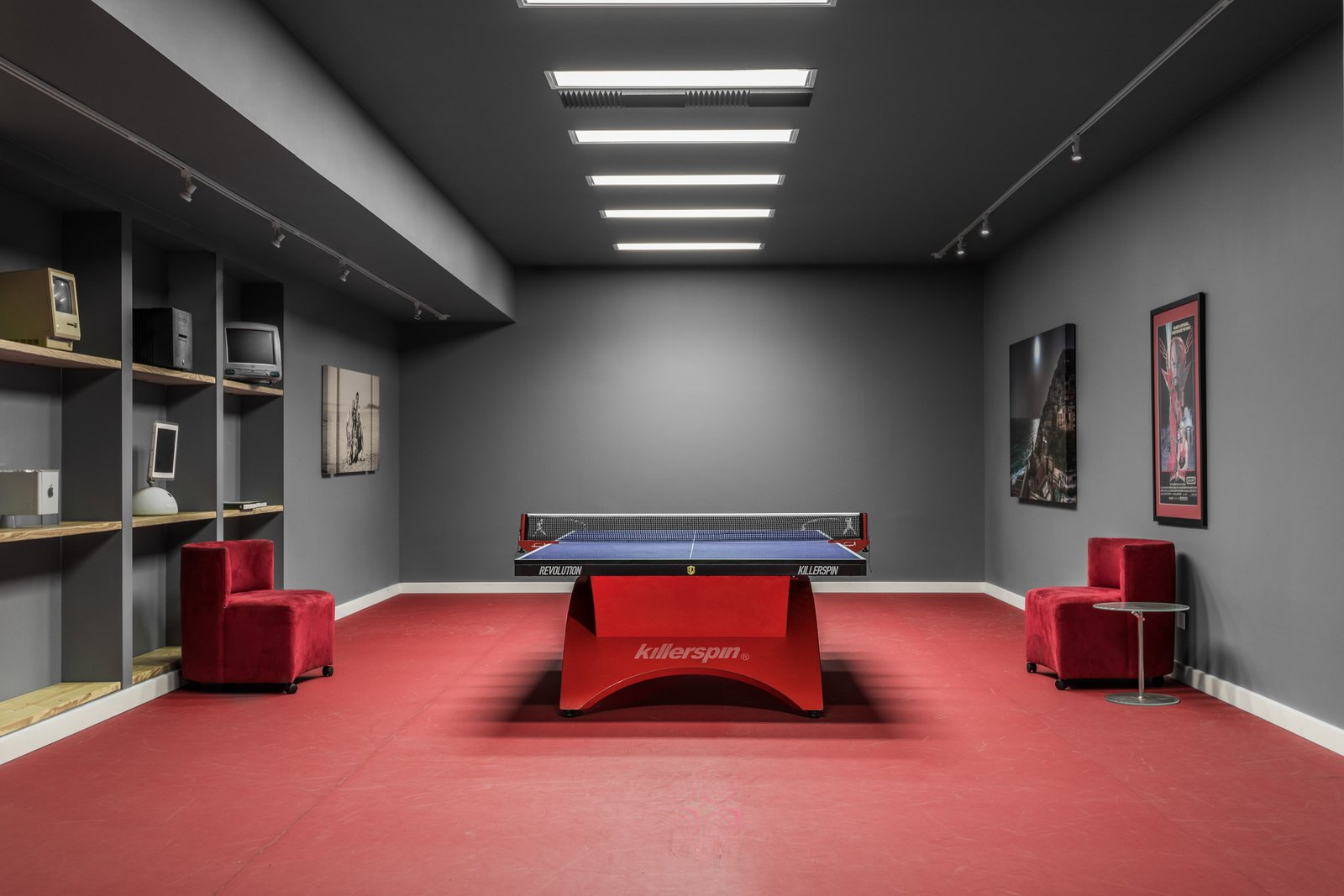 Table Tennis Room Tagged: Living Room, Ceiling Lighting, Track Lighting, Chair, and End Tables.  Copperwood by Kevin Swan