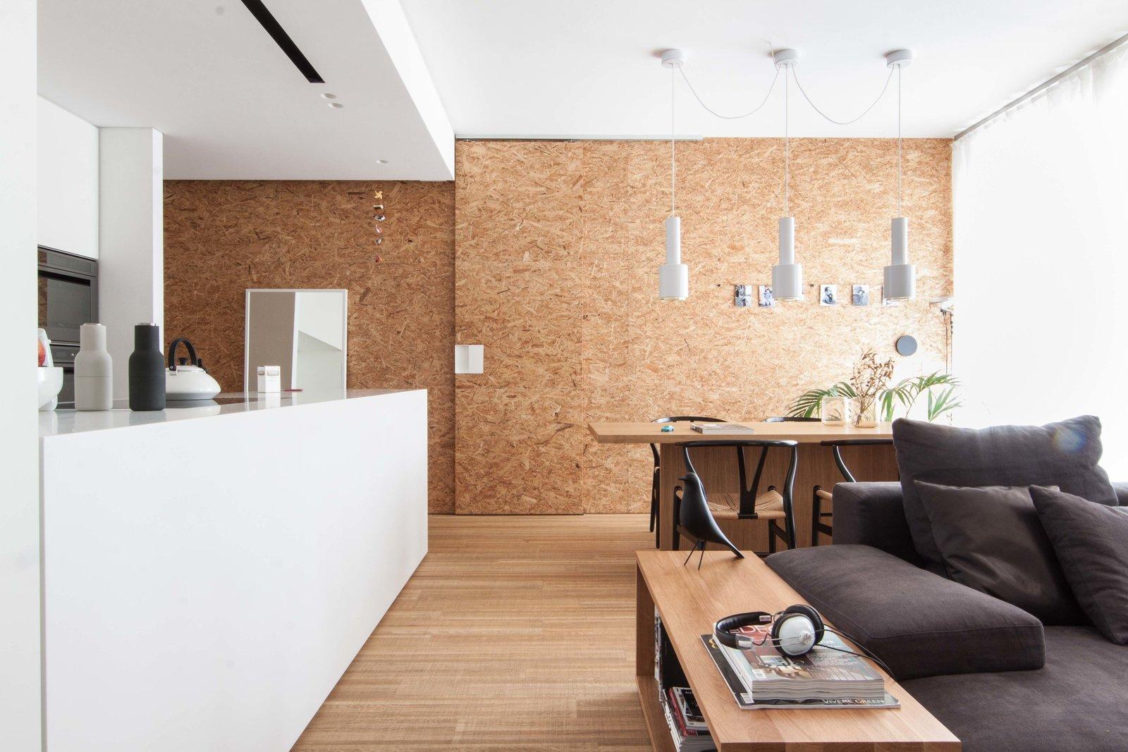 Tagged: Living Room, Ceiling Lighting, Pendant Lighting, Bench, Sofa, and Medium Hardwood Floor.  Interior LP by Didonè Comacchio
