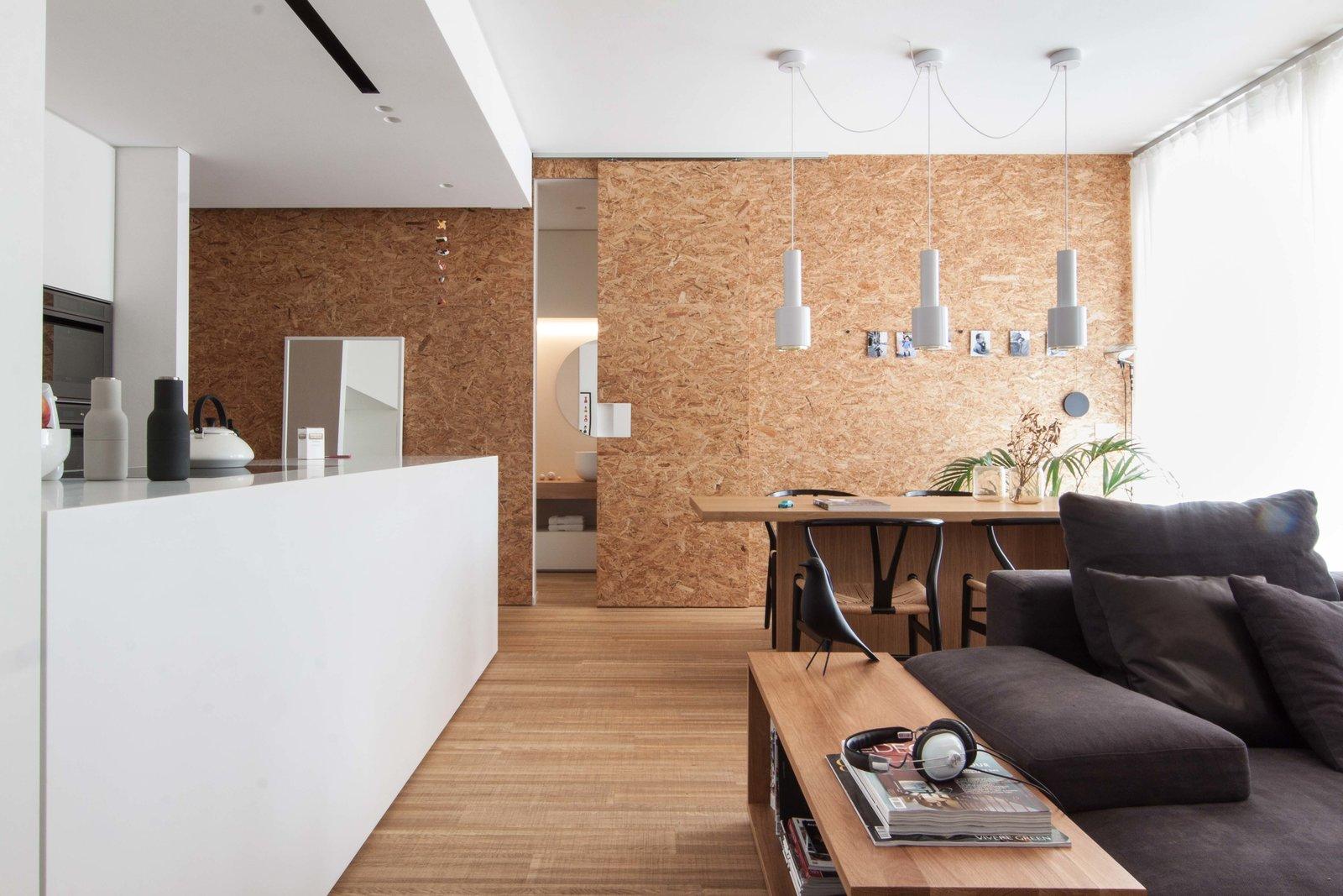 Tagged: Living Room, Sofa, Bench, Chair, Pendant Lighting, Medium Hardwood Floor, Table, and Ceiling Lighting.  Interior LP by Didonè Comacchio