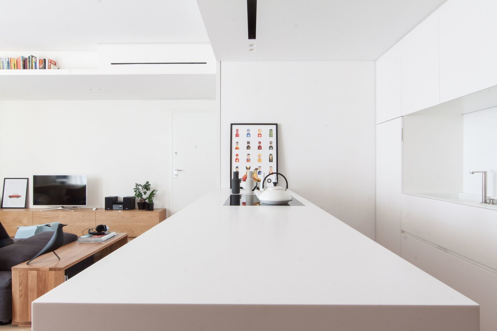 Tagged: Kitchen, Medium Hardwood Floor, Ceiling Lighting, White Cabinet, Refrigerator, Wall Oven, Cooktops, Microwave, Dishwasher, and Undermount Sink.  Interior LP by Didonè Comacchio